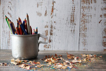 Pencils In A Mug And Shavings On The Wooden Ground