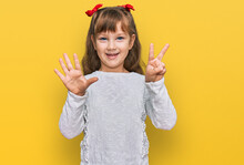 Little Caucasian Girl Kid Wearing Casual Clothes Showing And Pointing Up With Fingers Number Seven While Smiling Confident And Happy.