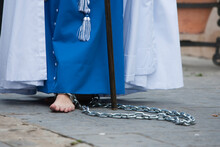 Low Section Of Woman With Chain On Legs Standing Outdoors