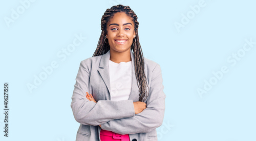Fotografía Young african american woman with braids wearing business clothes happy face smiling with crossed arms looking at the camera