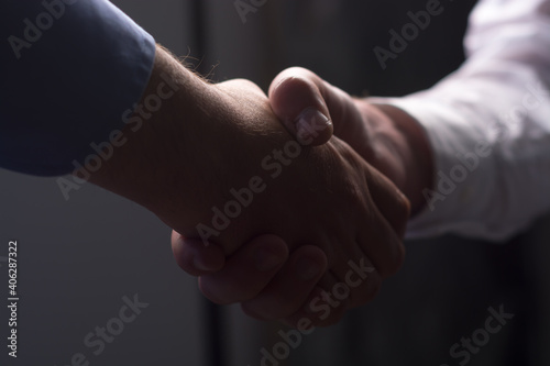 Fototapeta Close-up Of Business People Shaking Hands Inn Office