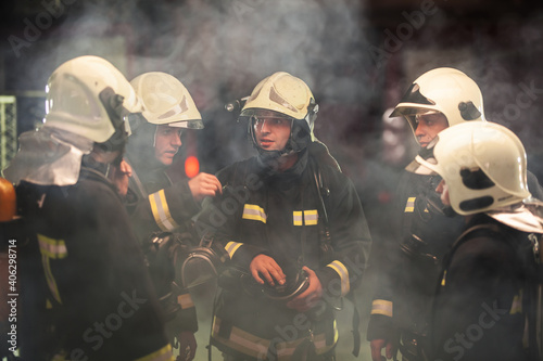 Canvastavla Firefighters Discussing While Standing On Land