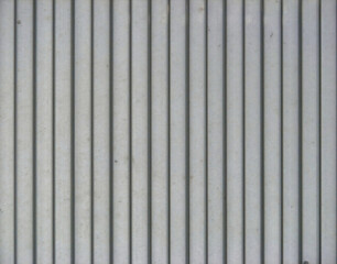 Metal striped grey wall as background