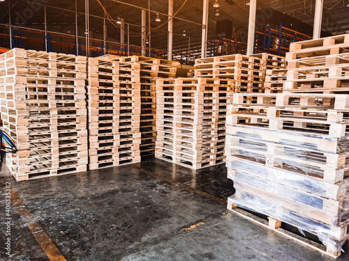 Obraz Worker driving forklift loading shipment carton boxes goods on wooden pallet at loading dock from container truck to warehouse cargo storage in freight logistics, transportation industrial, delivery - fototapety do salonu