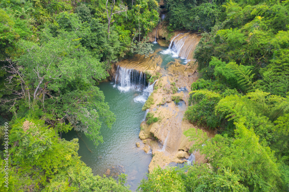 Fototapeta Aerial view of Palata Waterfall. Nature landscape of Tak in natural park with forest trees in travel trip on holiday and vacation, tourist attraction. Umphang, Thailand.