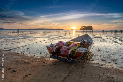 Fotografiet Deck Chairs On Beach Against Sky During Sunset