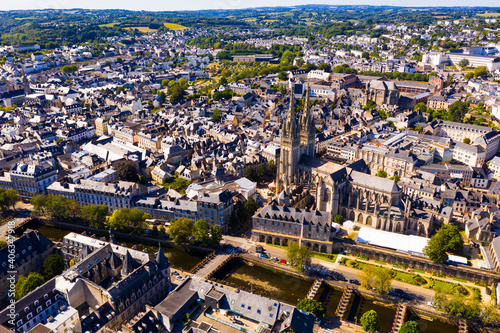 View from drone of old traditional houses in historic part of Quimper town at summer day, France