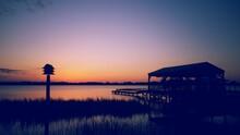 Gazebo On Lake During Sunset