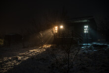 Wooden House In Winter Forest. Mountain House In The Snow At Night. Misty Night.