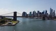 Brooklyn Bridge Over East River By Manhattan Against Sky