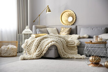 Cozy Living Room Interior With Knitted Blanket On Comfortable Sofa