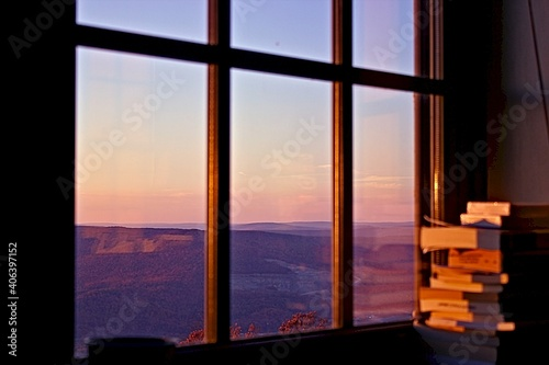 View Of Moutains Through Window At Sunset