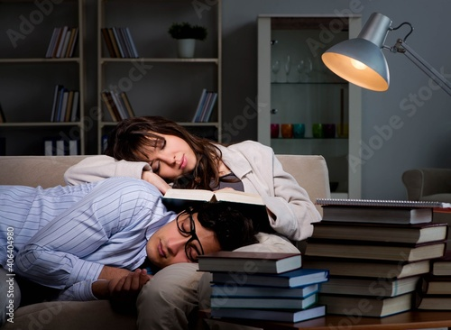 Obraz Two students studying late preparing for exams - fototapety do salonu