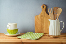 Table With Tablecloth And Kitchen Utensils. Spring And Easter Mock Up For Design