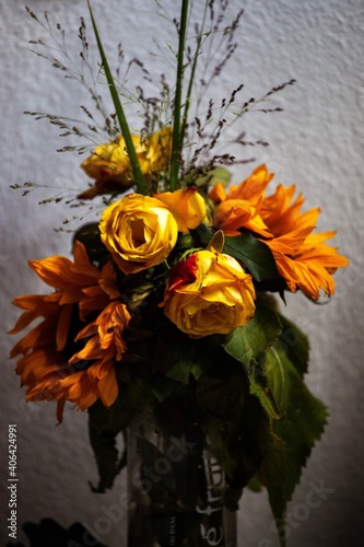 Fototapeta wilting flowers in vase