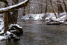 Freshly Fallen Snow Covers The Trails, Forest, And Creek At Honey Creek Reserve In Tipp City, Ohio.