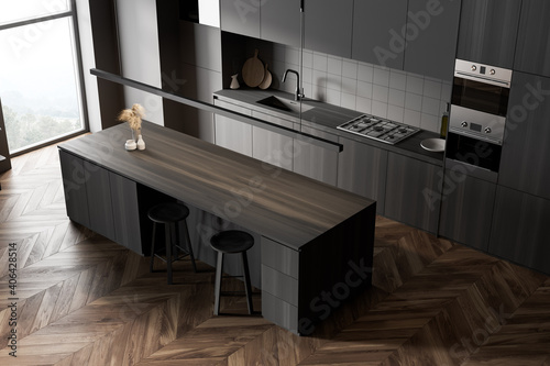 Gray and wooden kitchen corner with cupboards, top view