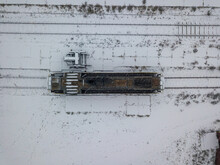 Diesel Locomotive Covered With Snow. Snowy Day, Blizzard. Aerial Drone Top View.