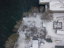 Electric Pole On The Snowy Shore. Snowy Day, Blizzard. Aerial Drone View.