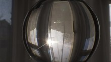 Lens Ball With Light Rays From Sun Coming Through Curtains Indoors. Truck Right