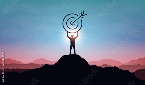 Obraz Targeting the business goal and achievement success concept. Businessman standing on top of mountain and holding target board at sunset background. Vision of businessman towards organization company - fototapety do salonu