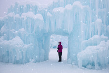 Woman Posing In The Doorway Of A Beautiful Ice Castle