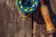 Close Up. Fly Fishing Rod With On Wood Background.