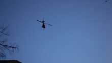 Firefighting Helicopter Dropping Water On A Large Wildfire