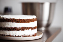 Three Layers Chocolate Cake With A Whipped Cream Filling.
