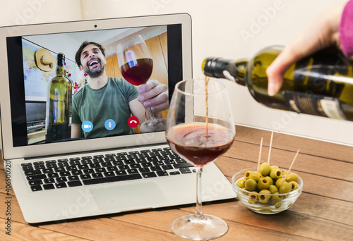 Young woman clinking with wine on video call party online with her boyfriend dur Fototapete