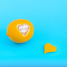 Creative Minimal Valentines Day Concept With Lemon And Heart Shape Peeled On Pastel Blue Background