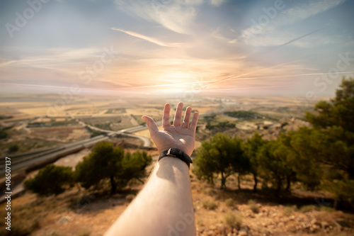 man showing the world with his hand