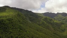 Mountain Landscape On Tropical Island With Mountain Peaks Covered With Forest.