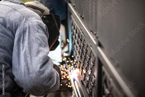 Fotografie, Obraz Professional worker performs work on start of sliding gate