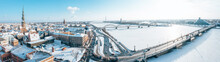 Beautiful Winter Day In Riga Over Frozen River Covered In Ice. White Winter In Latvia.