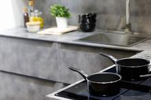 Modern Kitchen With Non-stick Saucepans