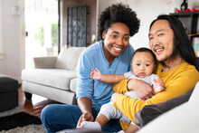 Happy Multiracial Parents Spending Time With Their Son