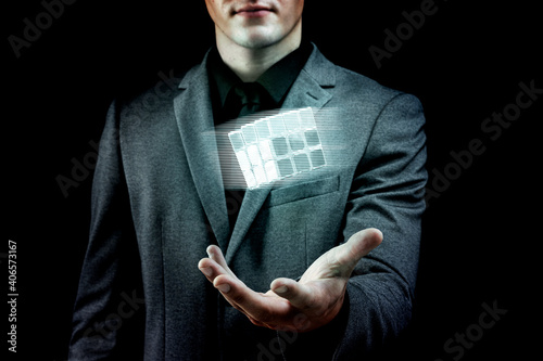 Businessman holding innovative combination puzzle cube