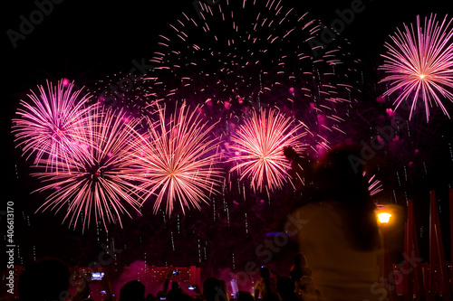 Beautiful colorful fireworks in the evening sky. #406613170