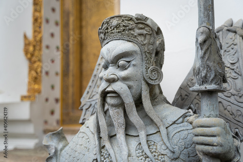 Billede på lærred Ancient portrait Chinese warrior stone doll carvings sculpture figures decorating in courtyards the famous place and travel attraction at Wat Pho temple at Bangkok, Thailand