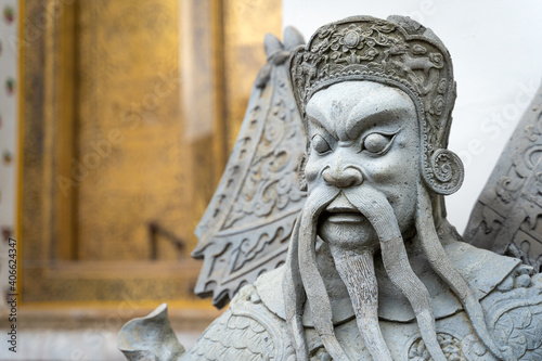 Fotografering Ancient portrait Chinese warrior stone doll carvings sculpture figures decorating in courtyards the famous place and travel attraction at Wat Pho temple at Bangkok, Thailand