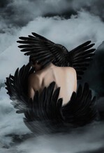 Surreal Concept Woman. Photo Manipulation. Black Swan Woman In The Sky.