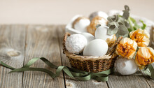 Spring Easter Composition With Eggs In A Basket And A Bouquet Of Flowers Copy Space.
