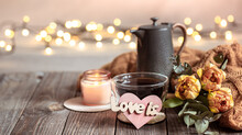 Cozy Composition For Valentine's Day With A Cup Of Tea, Decor Details And Flowers Close Up.