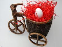 White Chicken Egg Lie In A Basket Stylized Under A Vintage Bike