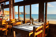 Panoramic View Of Sagres Beach From Inside A Restaurant. Algarve, South Of Portugal.