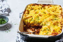 Vegan Shepherd's Pie With Lentils And Mashed Potatoes In Black Backing Dish. Vegan Healthy Food Concept.