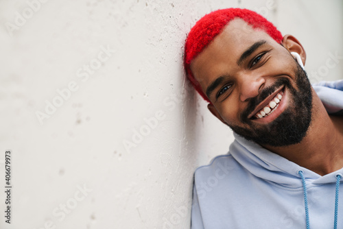 Happy african american guy smiling and looking at camera