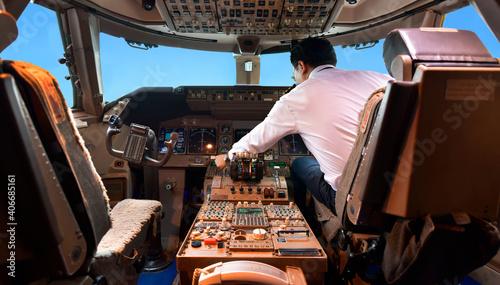 Vászonkép Airline pilot work in the cockpit