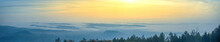Amazing Foggy Sunrise Over The City Of Graz With Schlossberg Hill And Church Of The Sacred Heart Of Jesus Tower, In Styria Region, Austria. Panoramic View From Plabutsch Mountain On Autumn Morning.